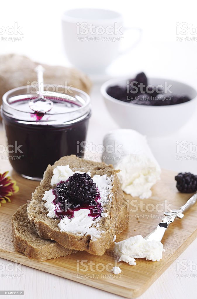 Breakfast with bread, blackberry jam and fresh goat cheese royalty-free stock photo