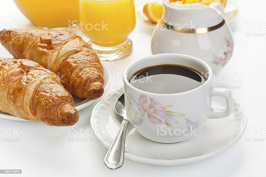 Breakfast with coffee and croissants royalty-free stock photo