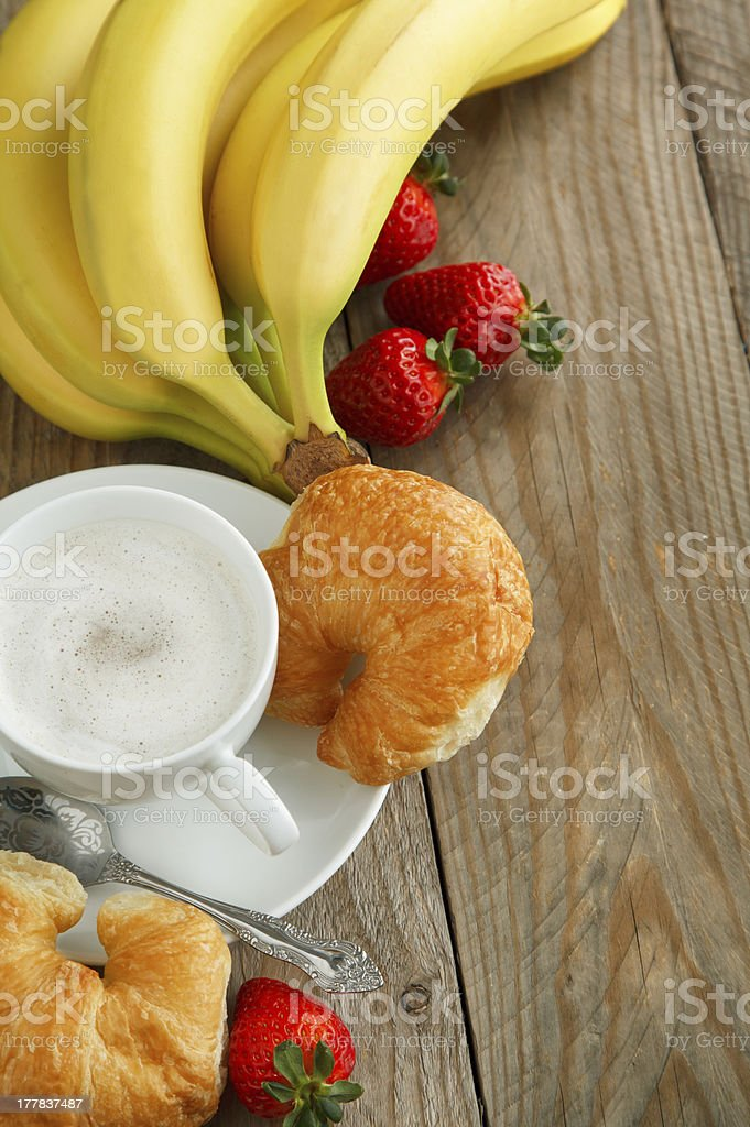 Breakfast with coffee, fresh croissants and fruits royalty-free stock photo