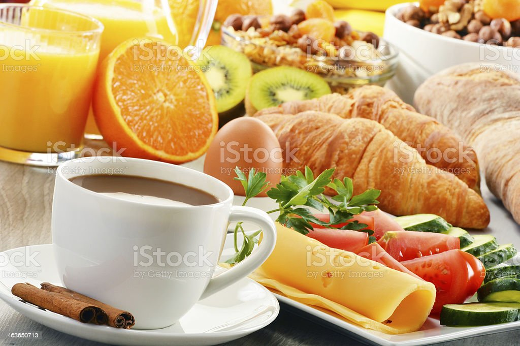 Breakfast with coffee, orange juice, croissant, egg, vegetables stock photo