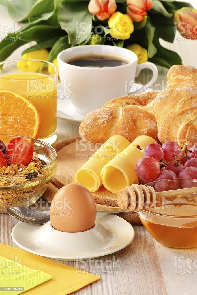 Breakfast with coffee, rolls, egg, orange juice, muesli and chee royalty-free stock photo