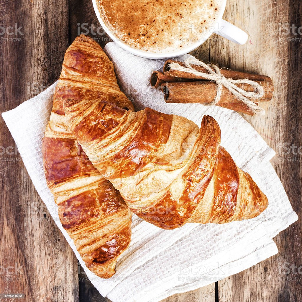 Breakfast with Croissants and Coffee on wooden rustic background royalty-free stock photo