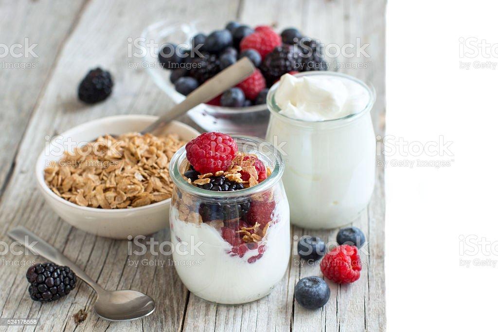 Breakfast with Fresh greek yogurt, muesli and berries stock photo