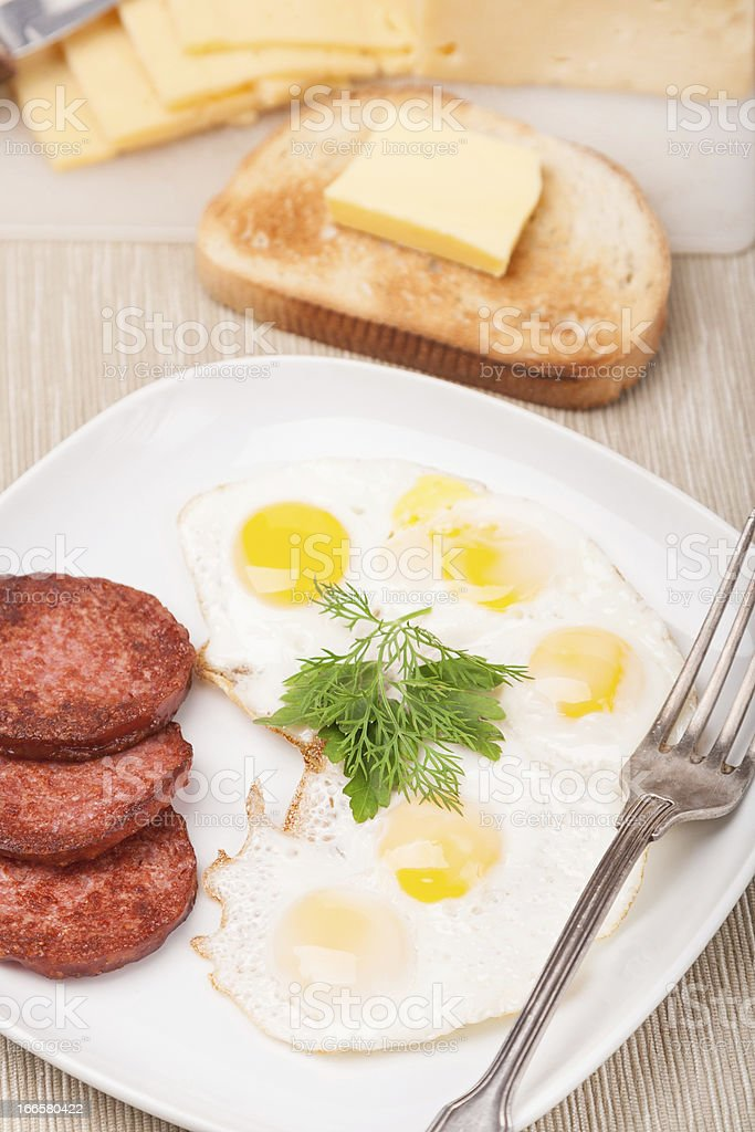 breakfast with fried eggs, sausage and toast on plate royalty-free stock photo