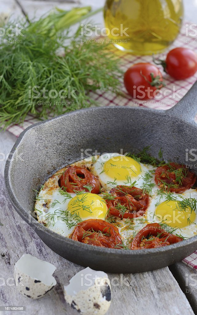Breakfast with fried quail eggs and cherry tomatoes royalty-free stock photo