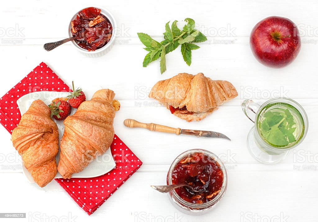 Breakfast with herbal tea and croissants stock photo