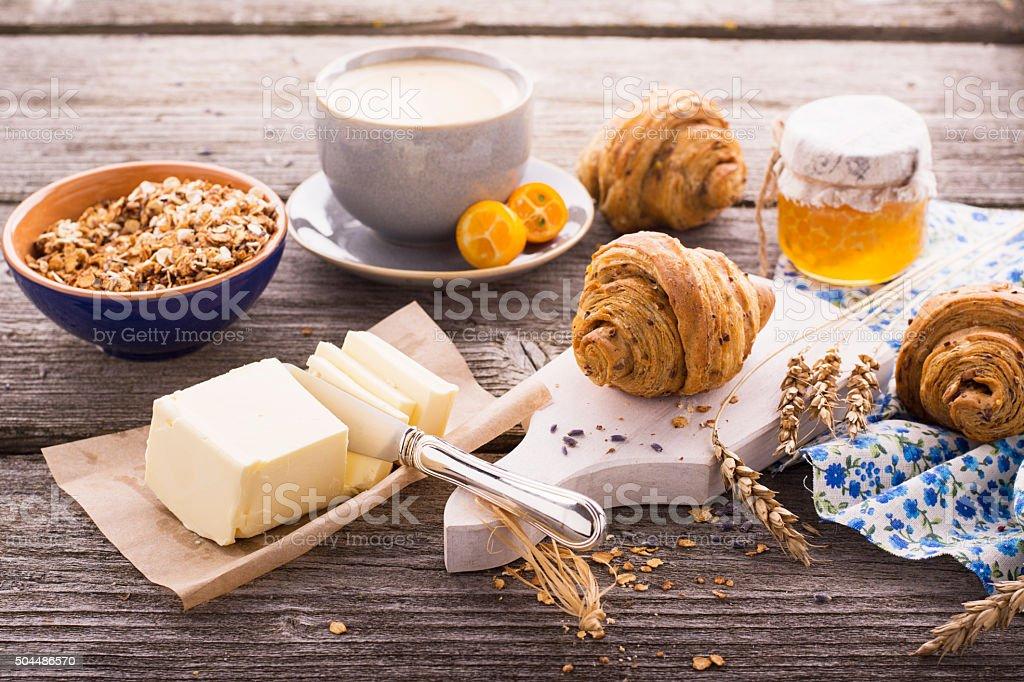 Breakfast with honey butter fresh croissants stock photo