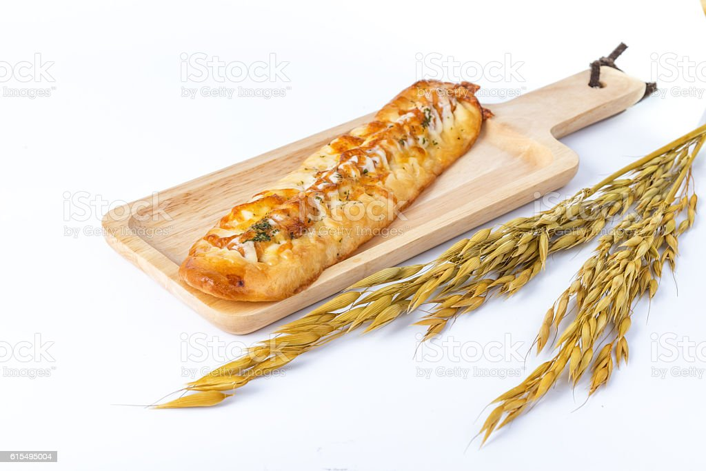 Breakfast with Long sausage cheese bread on wood plate stock photo