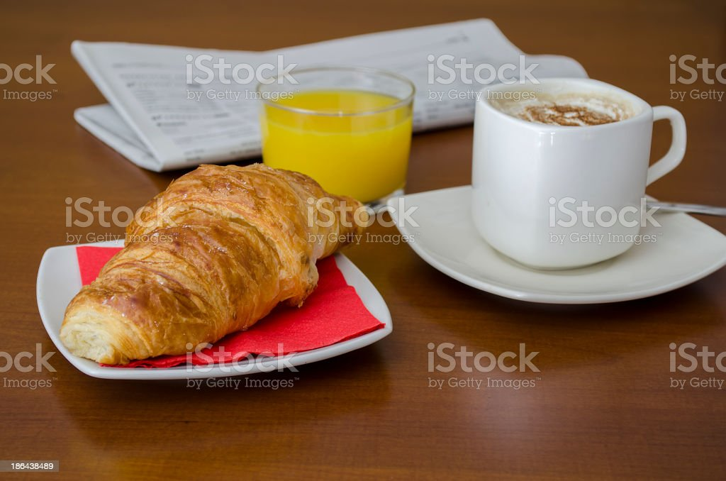 Breakfast with newspaper royalty-free stock photo