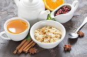 Breakfast with oatmeal, orange and jam