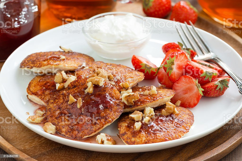 Breakfast with pancakes, fresh strawberries and cream, close-up stock photo