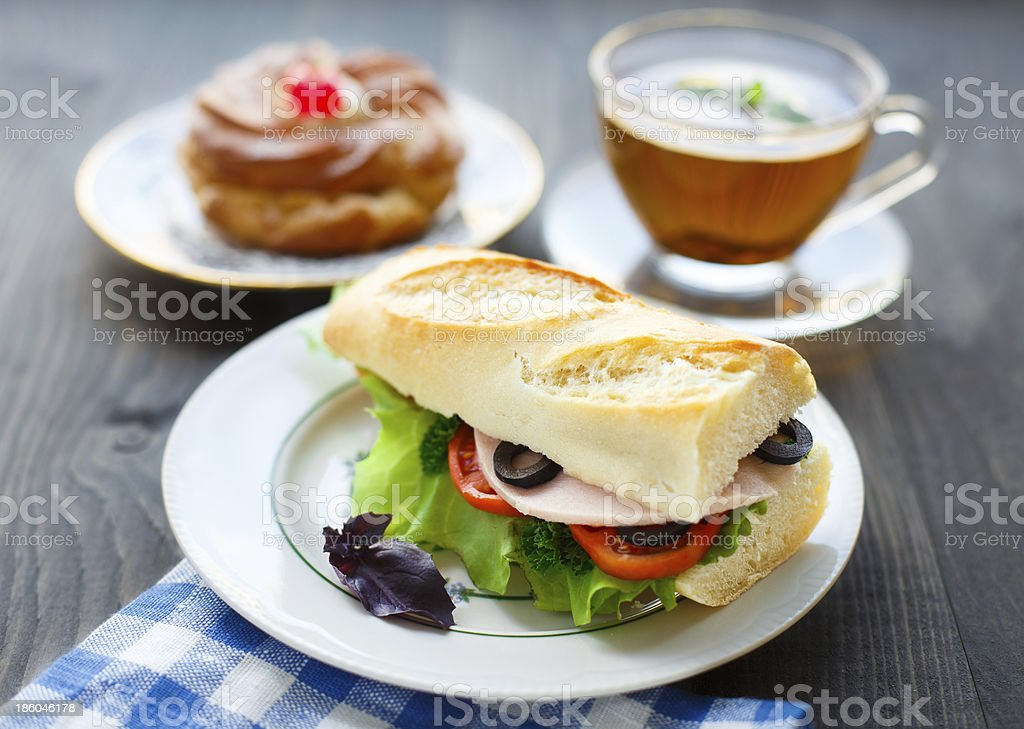 Breakfast with sandwich, tea and cake royalty-free stock photo
