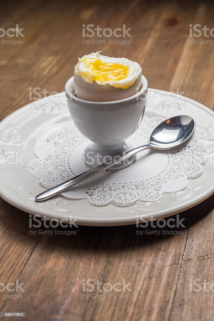 Breakfast with soft-boiled egg, over old wooden table stock photo