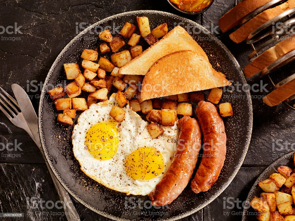 Breakfast with Sunny side up eggs and Sausage stock photo