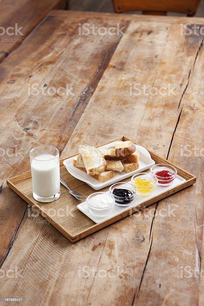 Breakfast with toast, jams, & milk royalty-free stock photo