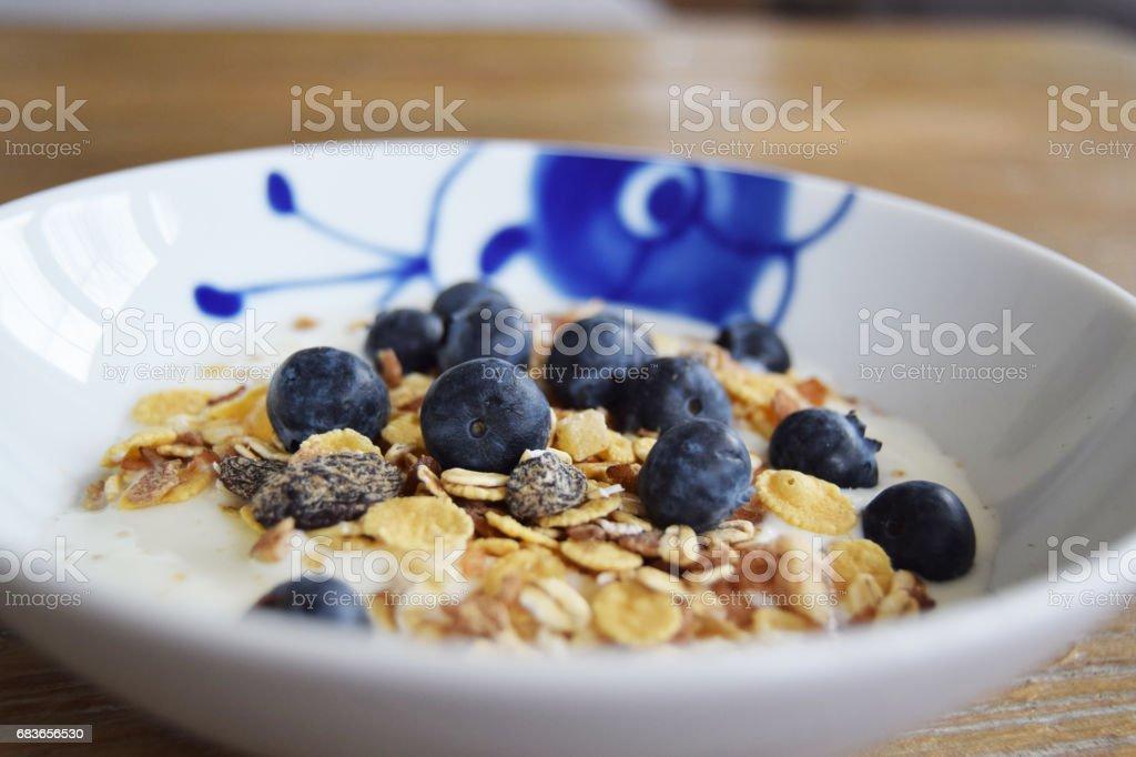 Breakfast yogurt, cereal and blueberries stock photo