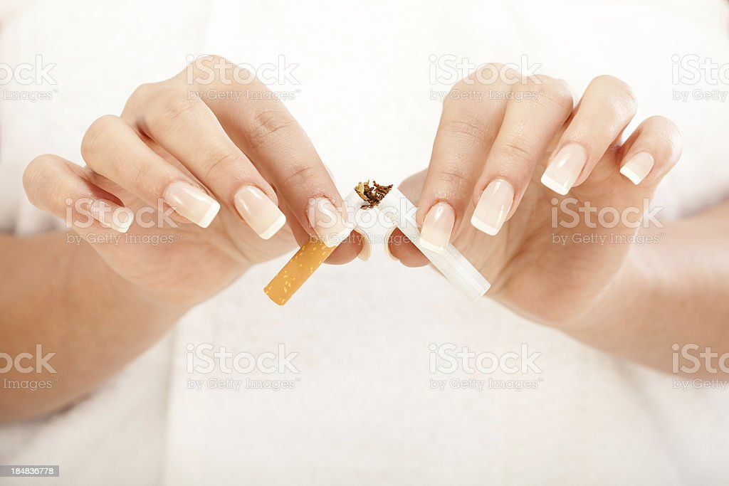 Breaking a cigarette royalty-free stock photo