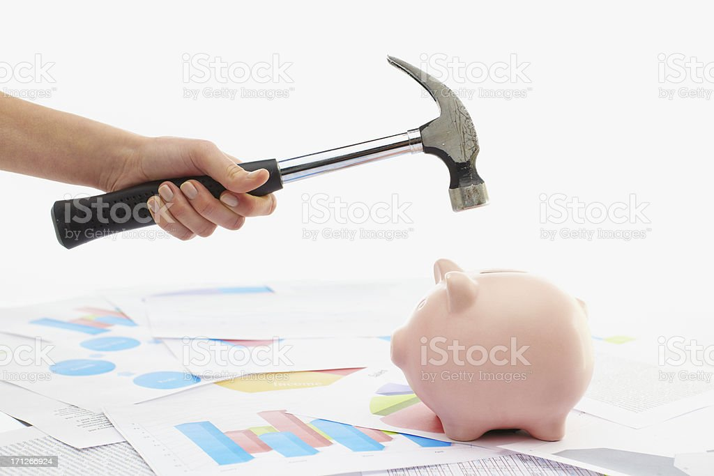 Breaking a piggy bank royalty-free stock photo