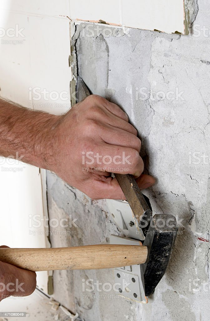 Breaking an old Wall... royalty-free stock photo