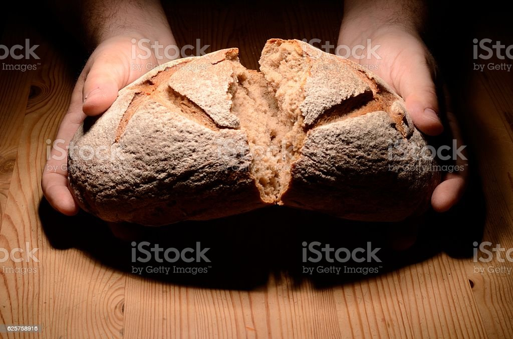 Breaking bread stock photo