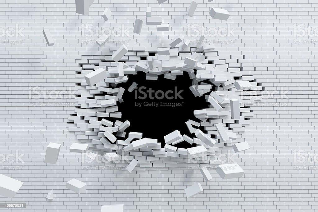 breaking brick wall stock photo