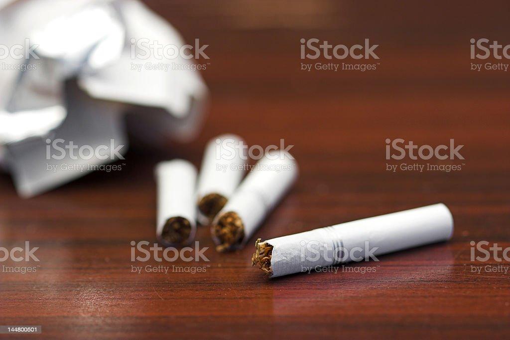 breaking cigarettes stock photo