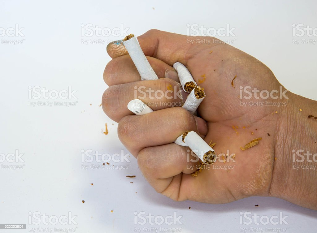 Breaking cigarettes stock photo