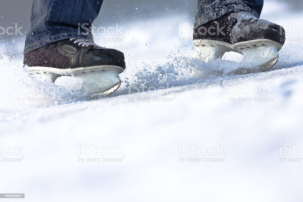 Breaking ice skates, plenty of copy space royalty-free stock photo