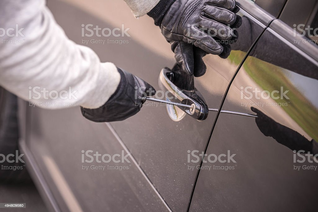 Breaking into car ! stock photo