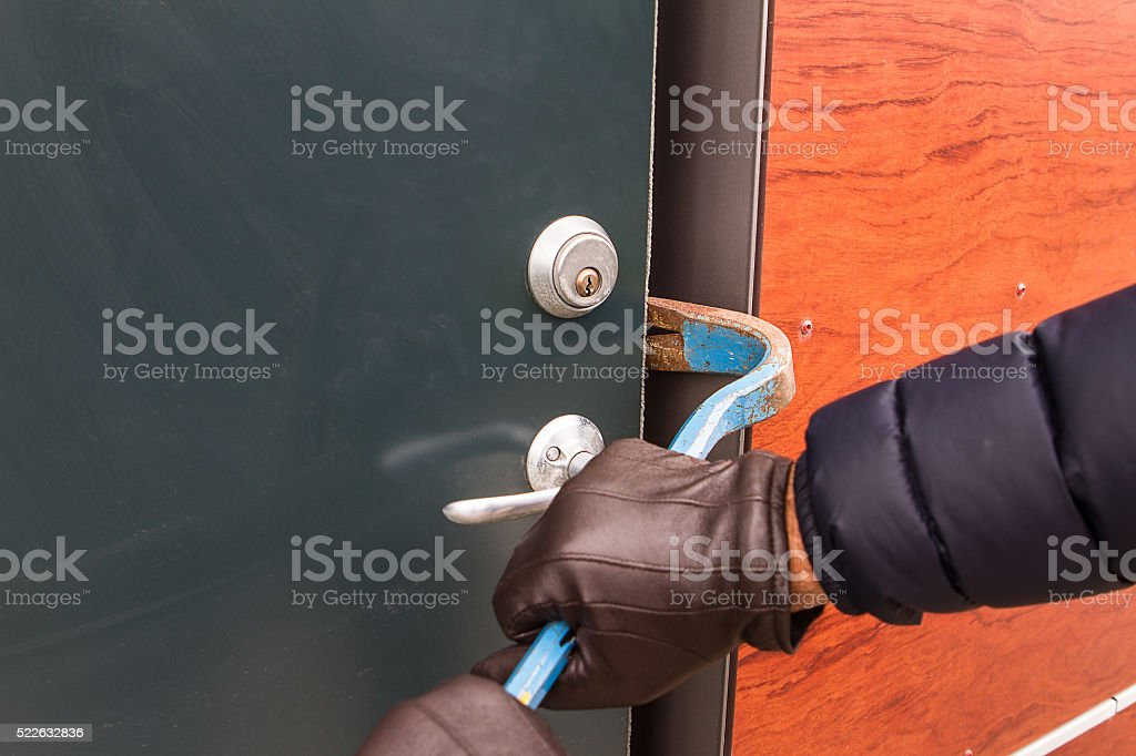 Breaking into houses stock photo
