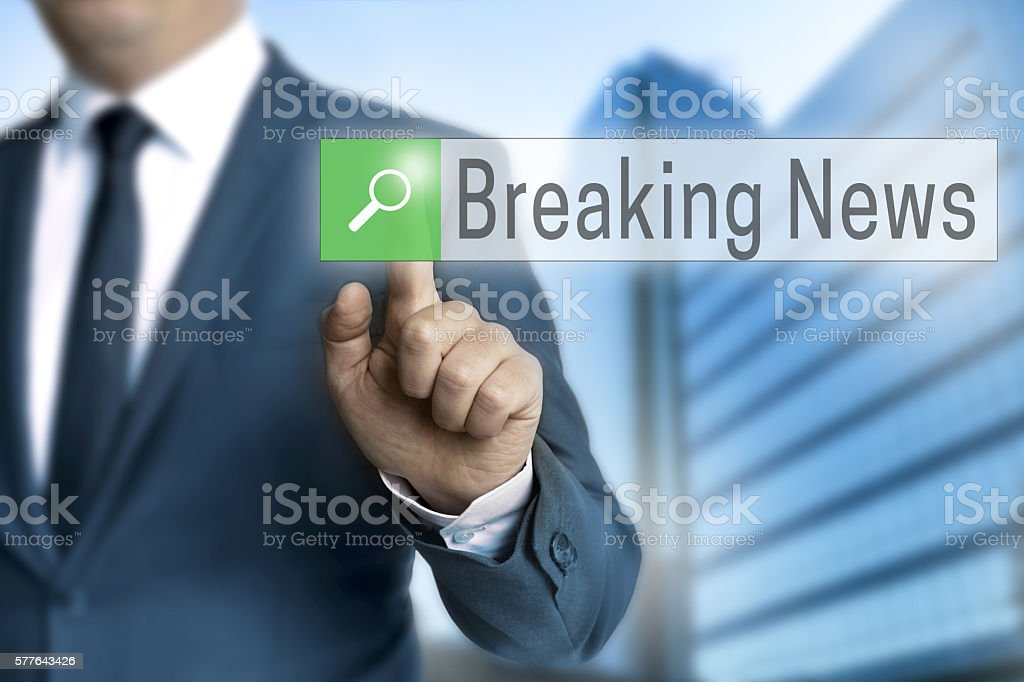 breaking news browser is operated by businessman stock photo