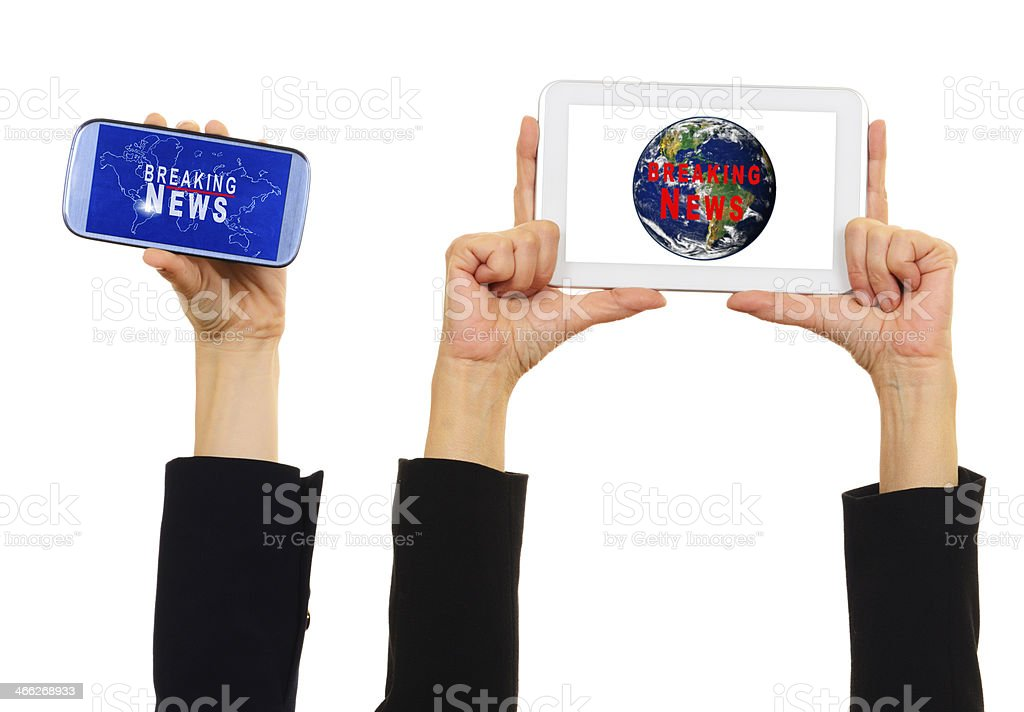 Breaking News on Smartphone and Tablet royalty-free stock photo
