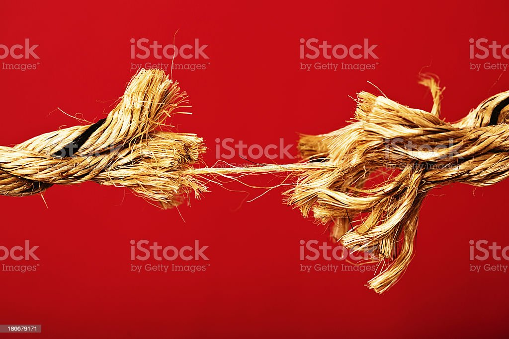 Breaking point! A rope is frayed to its final strand stock photo