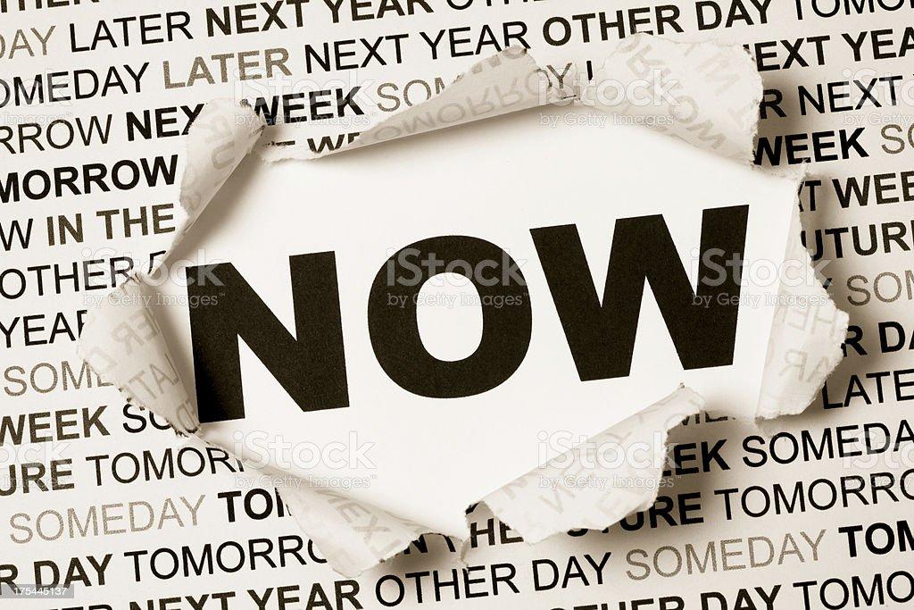 Breaking procrastination now stock photo