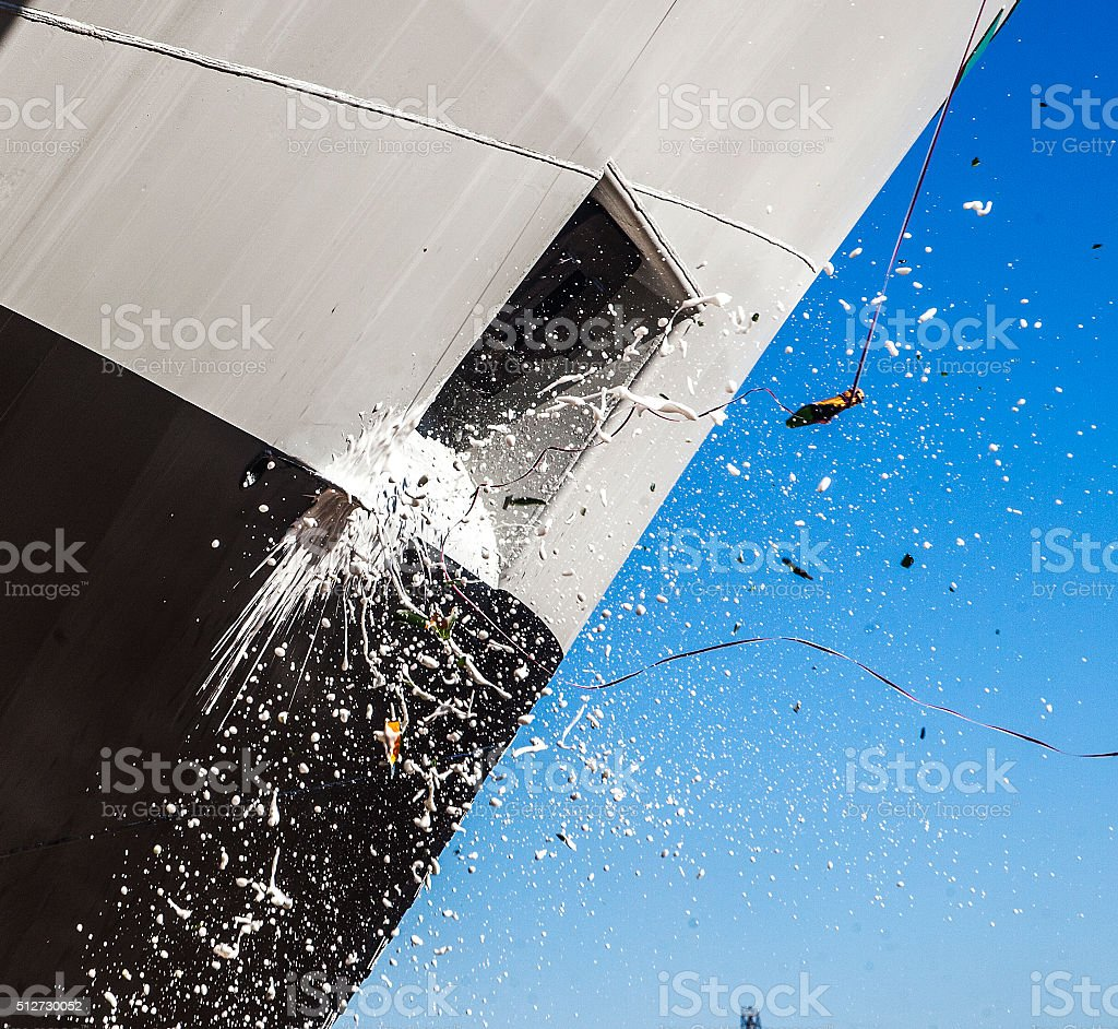 breaking the champagne on the ship stock photo