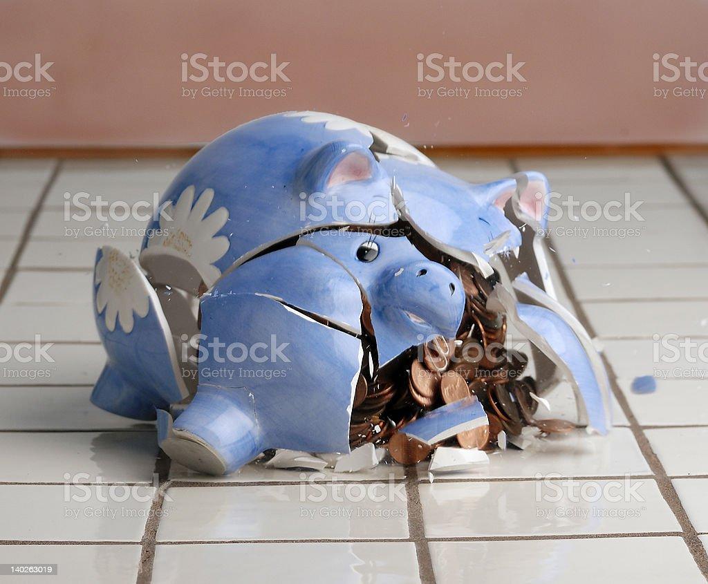 Breaking the piggy bank stock photo