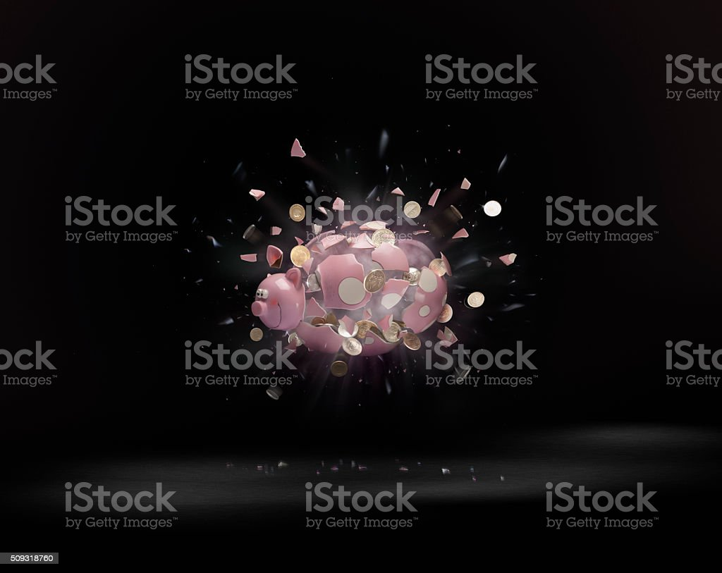 Breaking the Piggy Bank stock photo