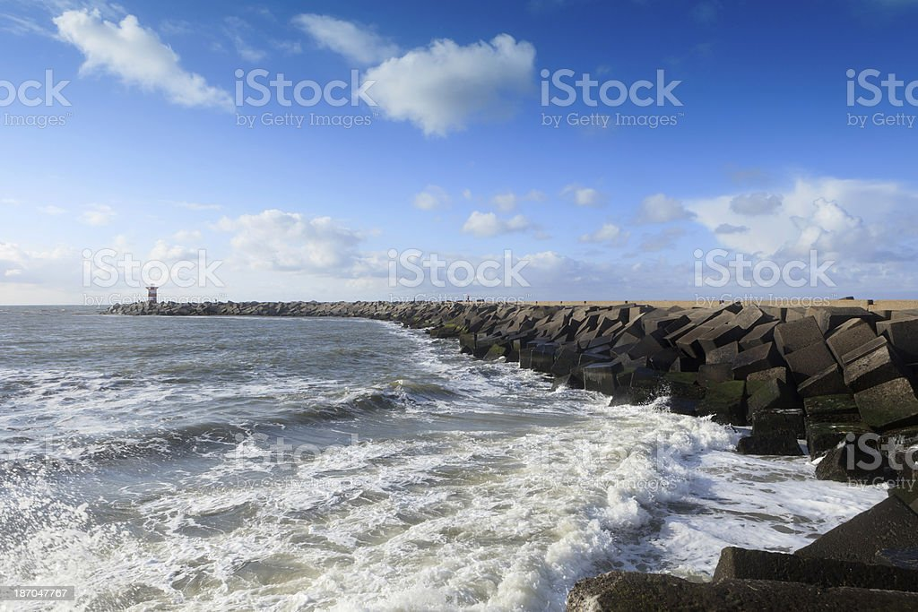 breaking waves on a jetty at Scheveningen stock photo