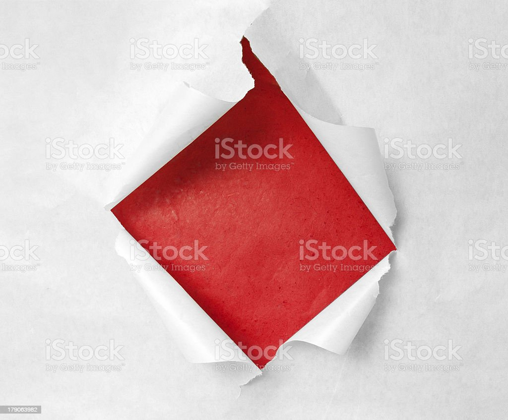 Breakthrough paper hole stock photo
