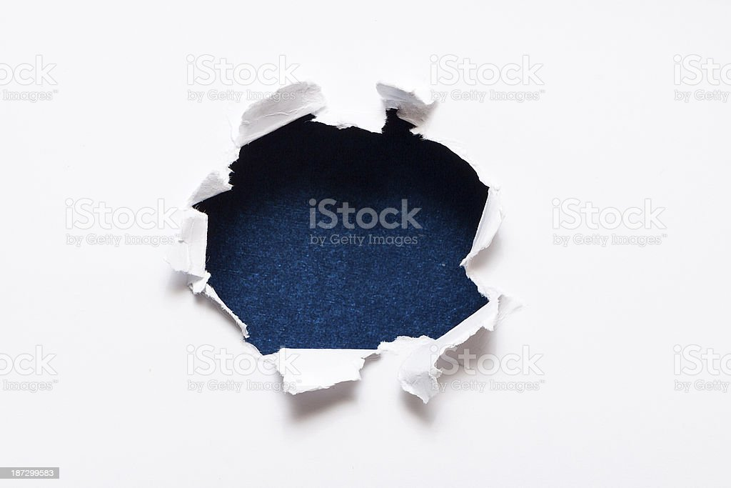 Breakthrough paper hole stock photo