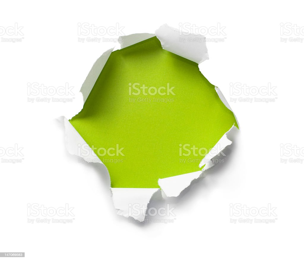 Breakthrough paper hole showing green color underneath stock photo