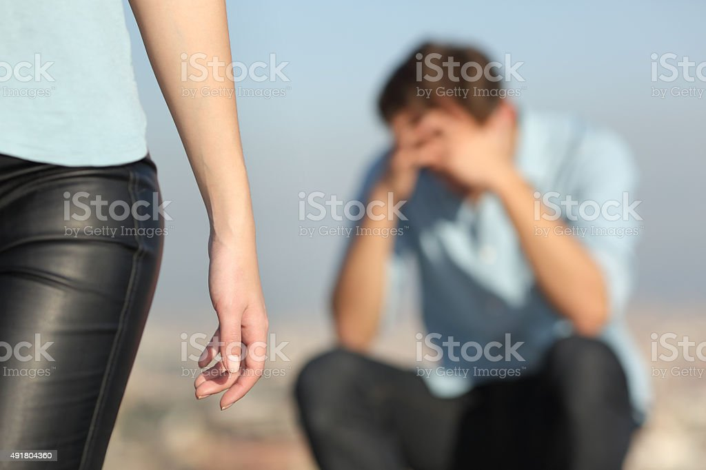 Breakup of a couple and sad man in the background stock photo