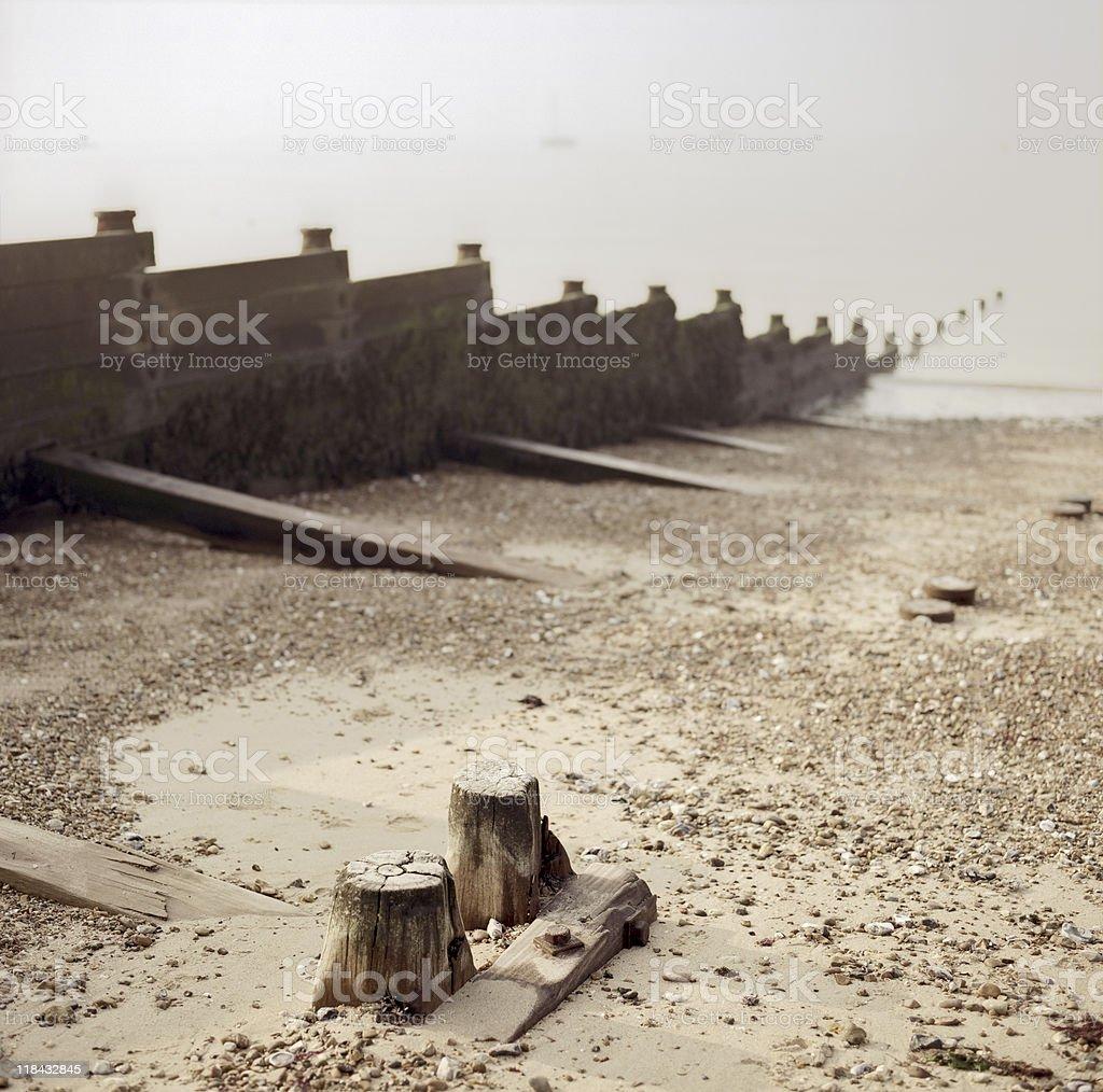 Breakwater (groyne) in the fog - English beach stock photo