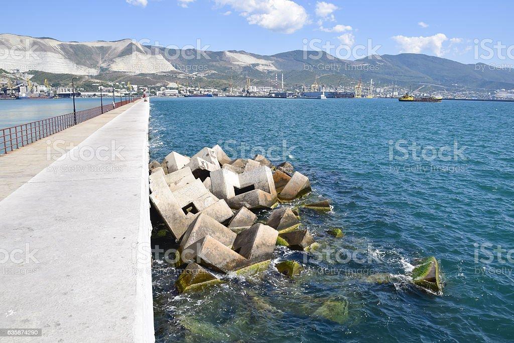 Breakwater of the rectangular stone figures. stock photo