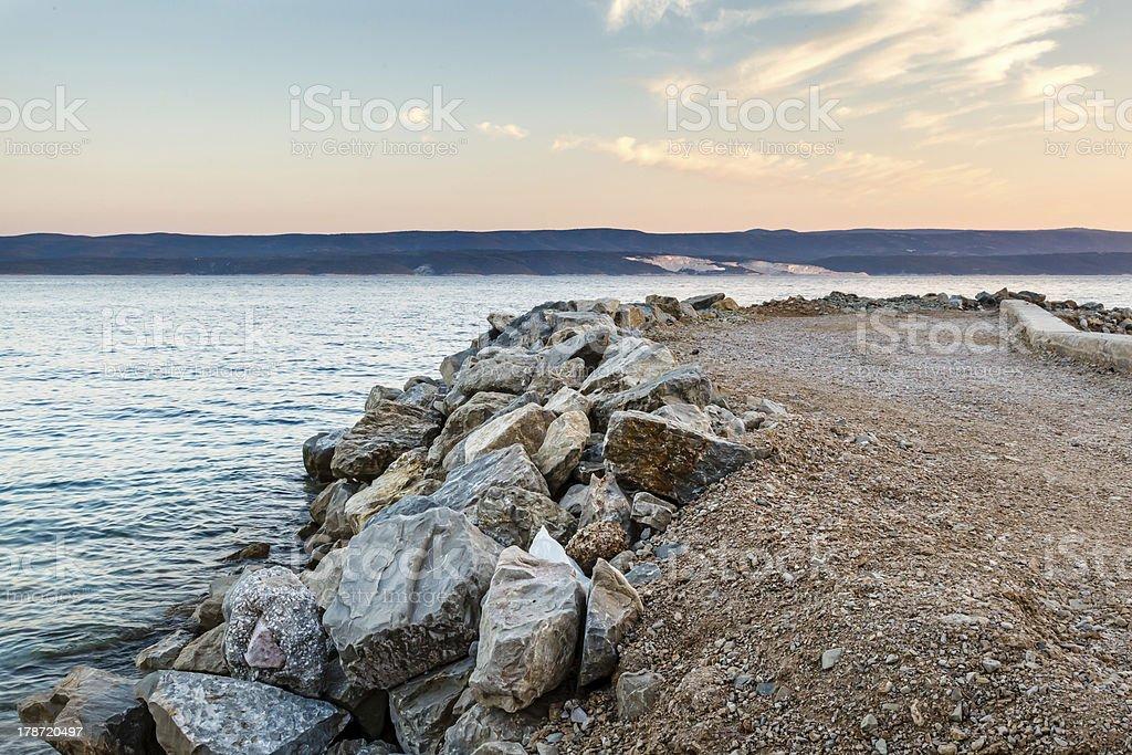 Breakwater on Makarska Riviera at Sunset, Croatia royalty-free stock photo