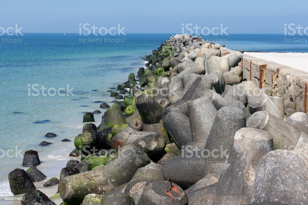 Breakwater with concrete tetrapods at German island Dune near Helgoland stock photo