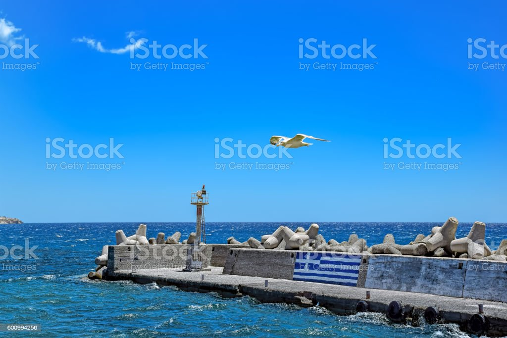 Breakwater with lighthouse on Crete stock photo