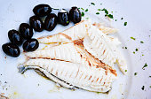 bream and black olives, high angle view