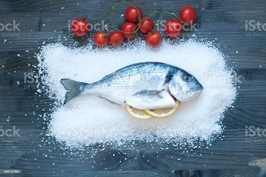 Bream cooked in salt and then baked in the oven stock photo