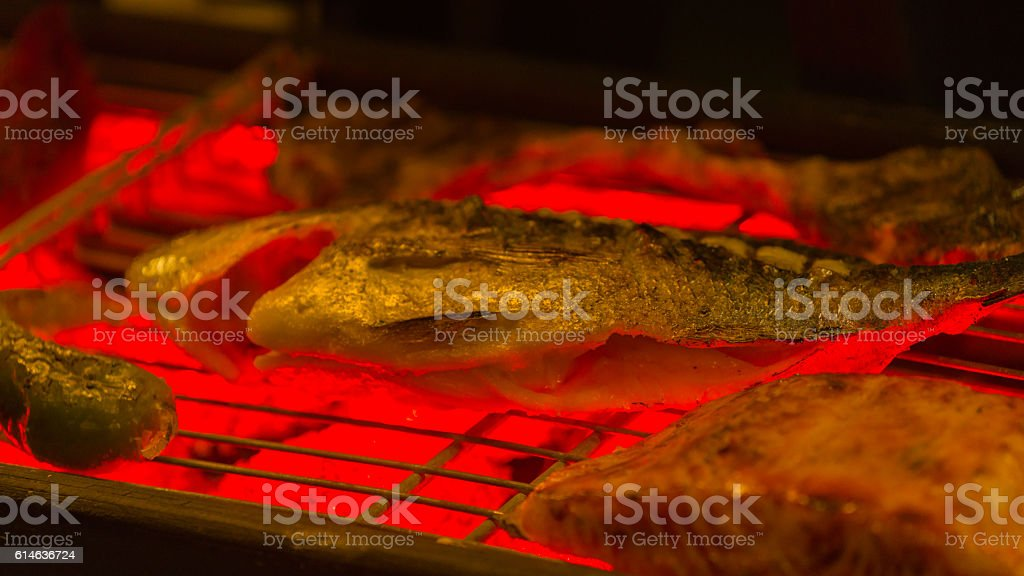 bream fry on the grille on a grill stock photo